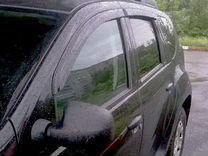 Ветровики Рено Дастер на двери